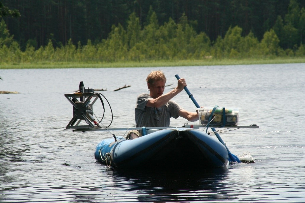 Figure 1. Ilmar Ansko performing the radiometric measurements on the Valguta Mustjärv (660 m x 470 m) in Estonia. The lack of the life jacket in this situation is justified by the cost of the radiometers.